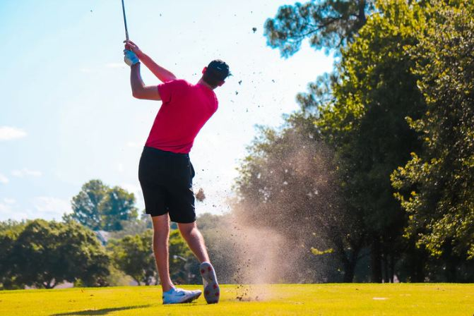 A photo of a man playing golf