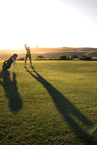 A photo of a person playing golf